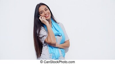 Attractive young woman talking on a mobile - Attractive...
