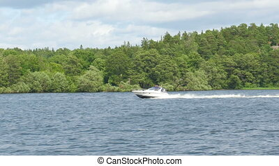 quot;speed boat going on scandianvian waters near stockholm,...