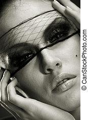 Beautiful woman portrait witha professional make-up. Skin...