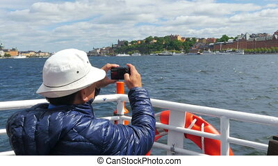 """tourist taking picture in sightseeing tour, stockholm, sweden"""