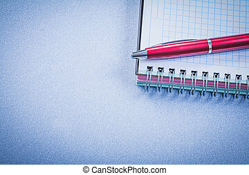 Red brio pen blank copybook office concept.