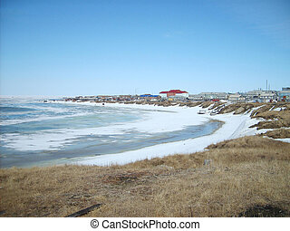 Coastal landscape of the tundra settlement The settlement on...