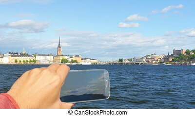"""tourist taking picture in sightseeing tour, stockholm,..."