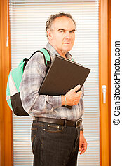Older man representing lifelong learning Man with school bag...