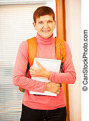 Older woman representing lifelong learning Woman with school...