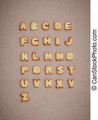 Cookies ABC in the form of alphabet A-Z on brown cardboard background, Valentines day