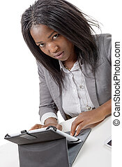 pretty young african american woman with a tablet somputer