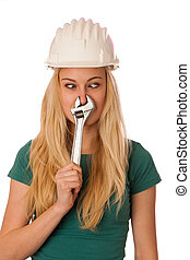 Woman with constructor helmet and tools gesturing stuffy...
