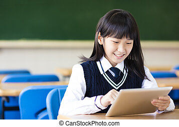 happy pretty  student girl with tablet  in classroom