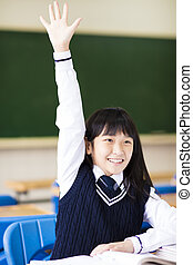 pretty  student girl raising hand in classroom