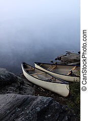 Parkside Canoes - A canoe sitting on the granite shoreline...