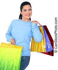 Happy Girl Shopping - beautiful young woman carrying...