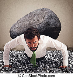Determined and powerful businessman - Businessman holds on...