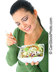 Healthy Woman Eating Salad - happy young woman eating her...