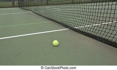 Tennis Ball Court - Yellow tennis ball and net on a green...