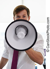 Portrait Serious Business Man With Megaphone In Office
