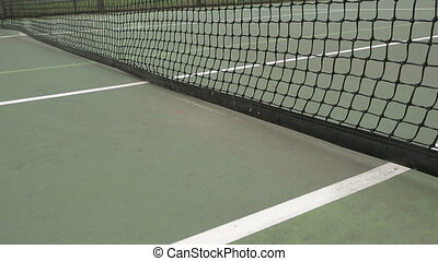 Tennis Ball Hits Net - Yellow tennis ball is hit into the...