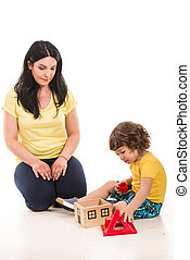 Mother and son playing with toy house