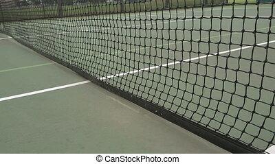 Tennis Ball Net Court - Yellow tennis ball and net on a...