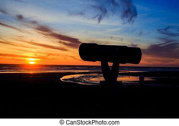 Telescope At Sunset On Beach