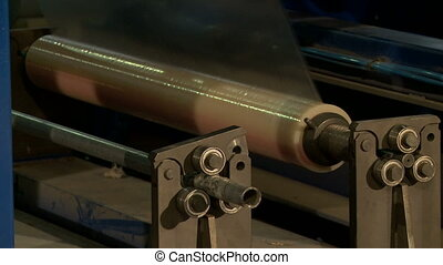 Film roll unwound during manufacturing process - View on...