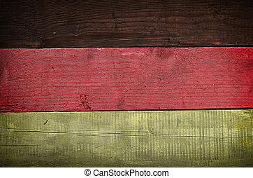 German flag on wood - Texture of an old used wooden table...