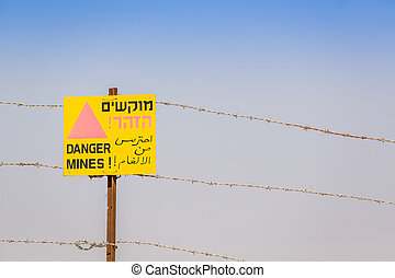 Danger Mines Warning sign and barbed wire Israeli border...