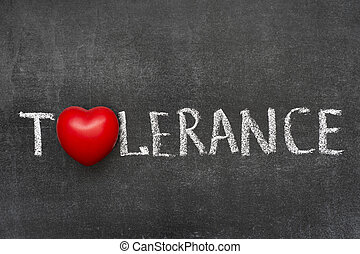 tolerance word handwritten on blackboard with heart symbol...