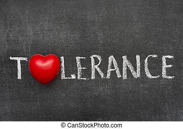tolerance word handwritten on blackboard with heart symbol...