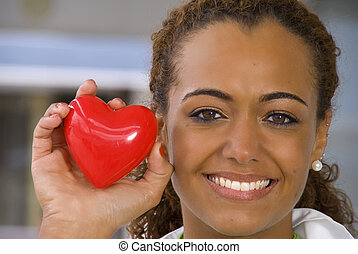 Cardiologist - A beautiful cardiologist holding a red heart