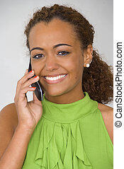 Woman on the Phone - An African American woman talking on...