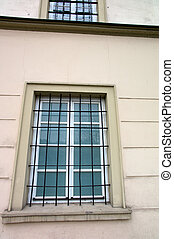barred windows in a building. symbol image for detention,...