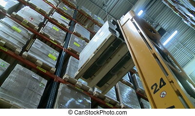 View on modern forklift in production warehouse - View on...