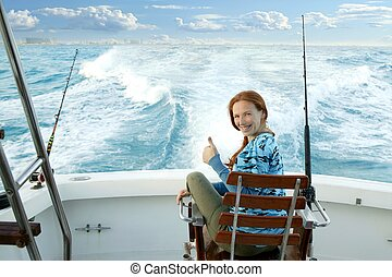 fisherwoman big game on boat chair ok sign happy