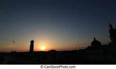 Silhouette of picturesque tower with sunset on background
