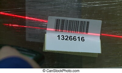 View of scanning box with laser barcode reader - View of...