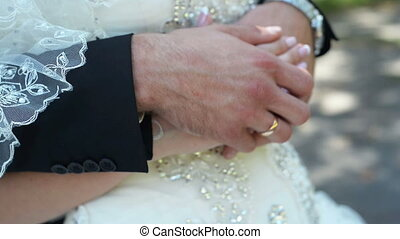 newlyweds hands with rings, hugs