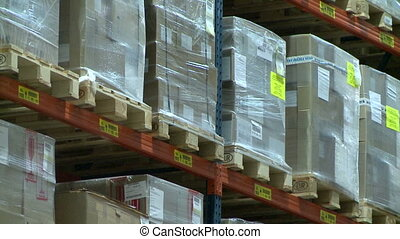 View from top to down on pallets with boxes at warehouse