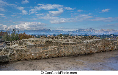 Alcudia wall and mountains - Cloudy day in Alcudia with old...