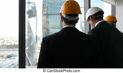 Architects team look at skyscrapers