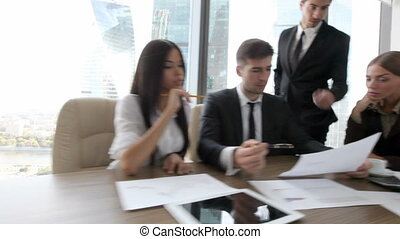 Business people discuss contract - Group of business people...