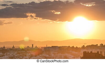 Sunset over the city timelapse View of Madrid, Spain. Photo taken from the hills of Tio Pio Park, Vallecas-Neighborhood.