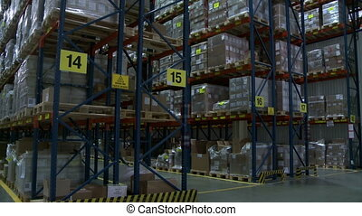 Warehouse View of racks with pallets and boxes - Storehouse...