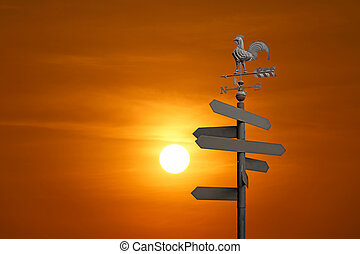 direction sign with blank spaces for text on beautiful sky...