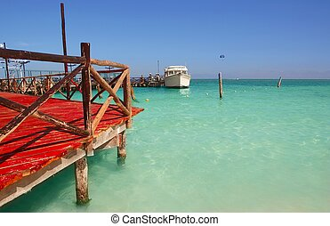 caribbean sea wooden dock mooring in Cancun Mexico