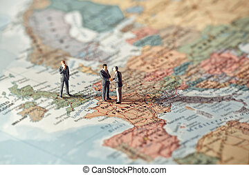 Miniature business people on map of Europe Color tone tuned...
