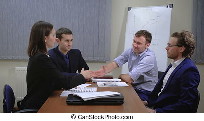 The team of young businesspeople. They work together with...