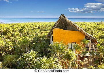 yellow house in Mexico tropical caribbean jungle