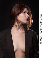 Woman in suit in fashion posing on black background