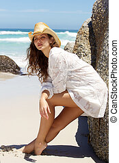 Young woman in summer dress posing at the beach